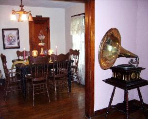 For those who prefer a formal dining area to have their breakfast, we offer you this dining room. Your order is served on a spacious carved solid oak table. If wanted, one can enjoy vintage music with their food. Maximum seating capacity is six.