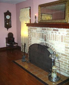 As you enter the front door, this cozy vintage fireplace catches the eye immediately. It is furnished with other vintage items such as the cathedral fire screen, illuminated electric smoker stand. This room has very comfortable sitting areas and is large enough to accommodate and extra person if necessary.